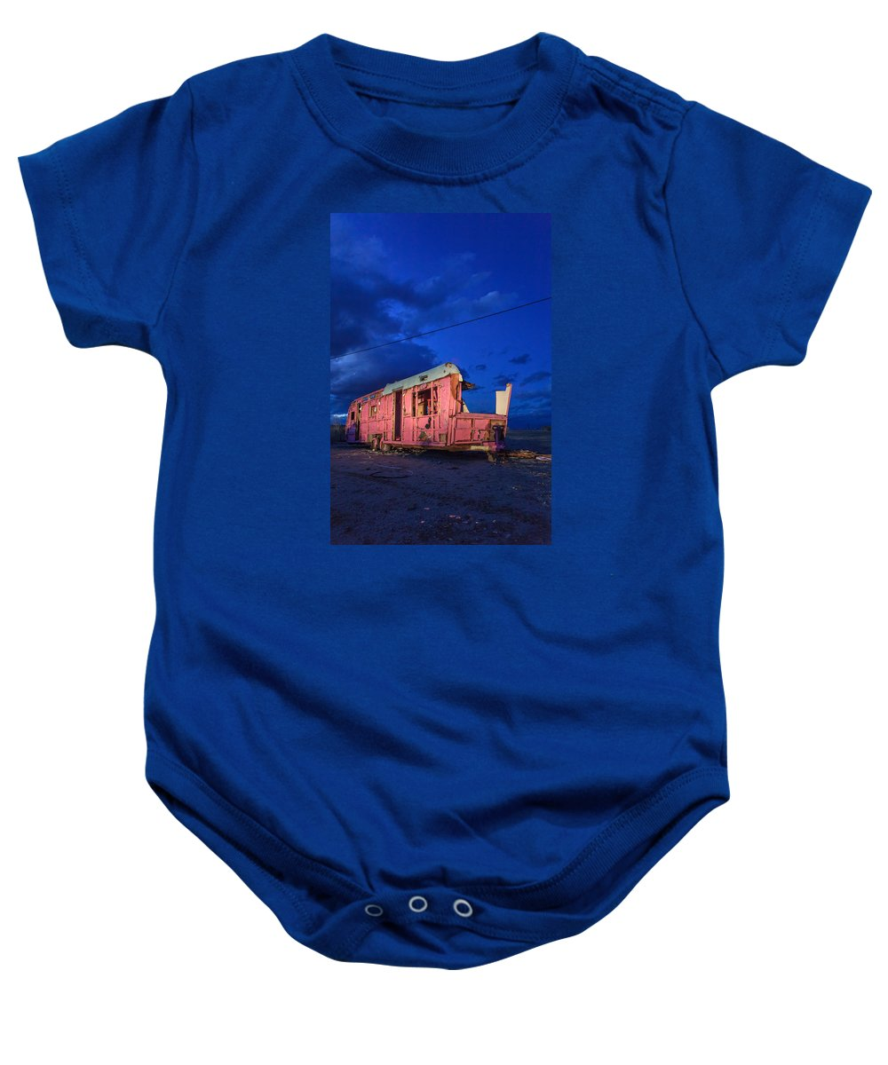 Salton Sea Baby Onesie featuring the photograph Why Pink Airstream Travel Trailer by Scott Campbell