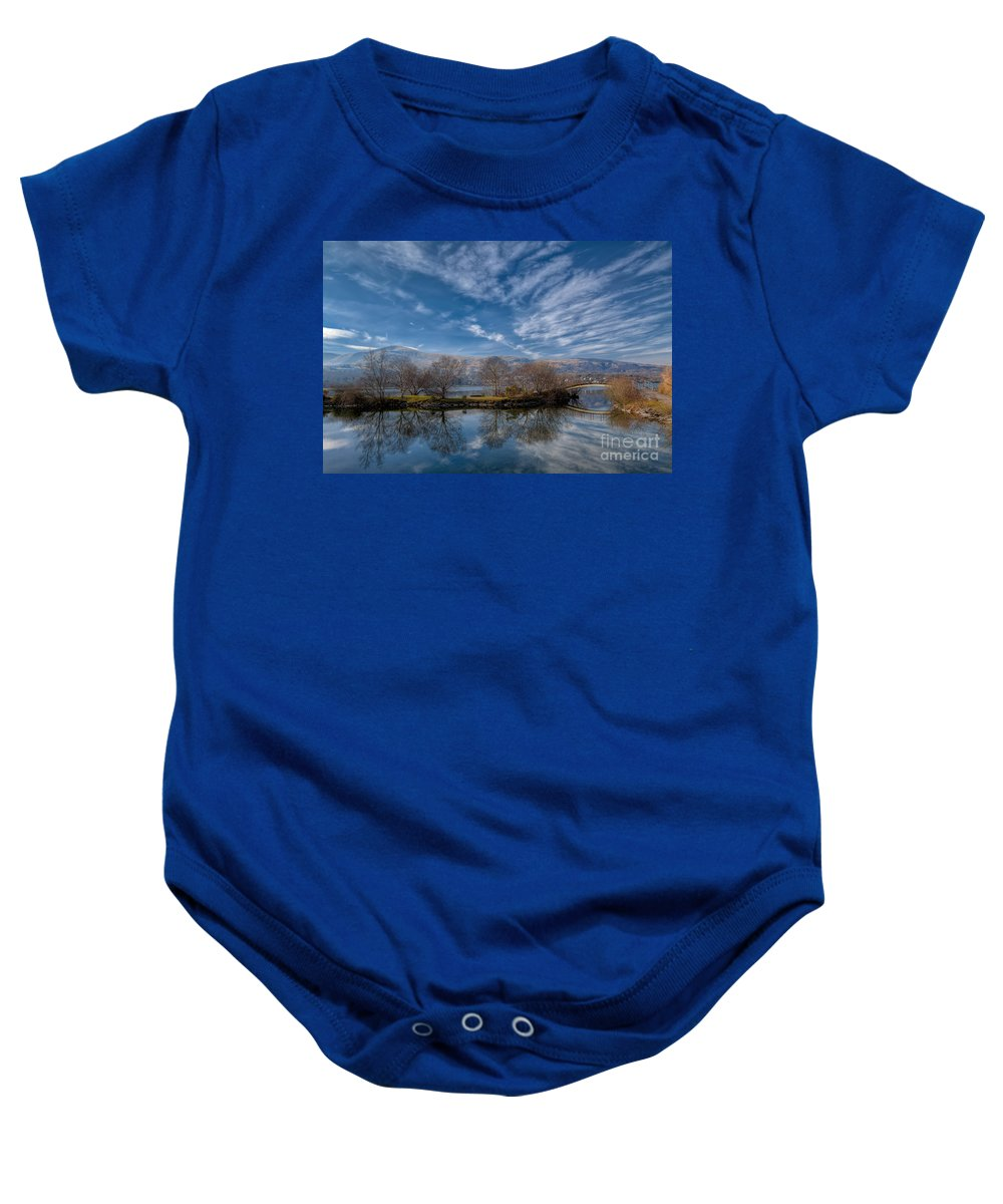 Llanberis Lake Baby Onesie featuring the photograph Winter Reflections by Adrian Evans
