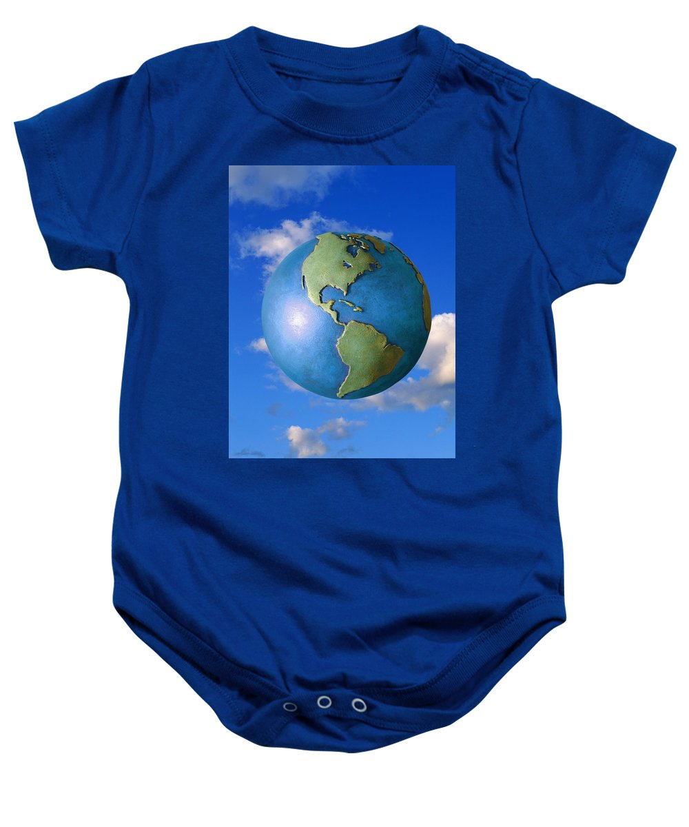 Clouds Baby Onesie featuring the photograph A Globe In The Sky by Don Hammond