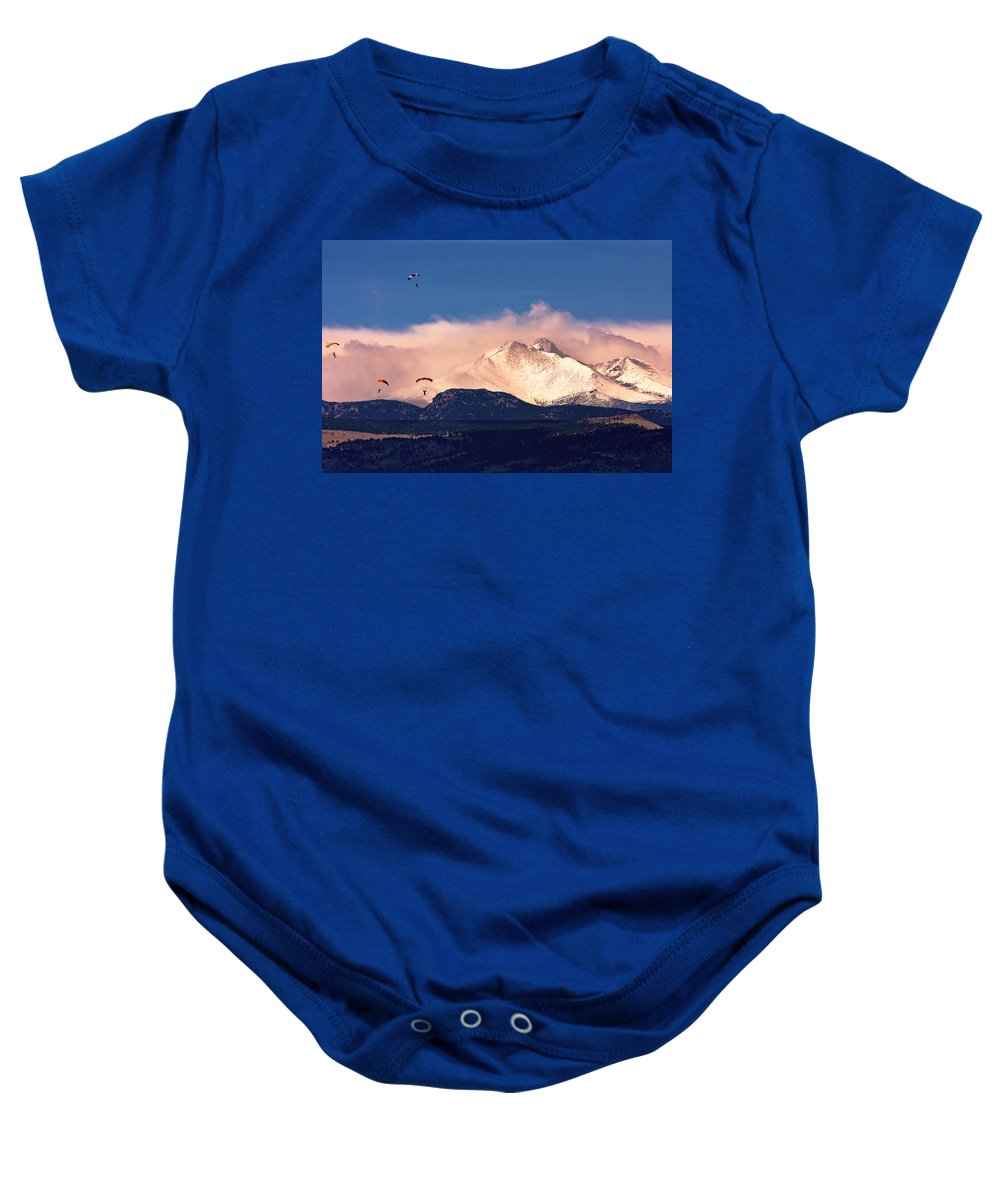 Skydive Baby Onesie featuring the photograph Four Skydivers With Longs Peak And Mount Meeker Rocky Mountain H by James BO Insogna