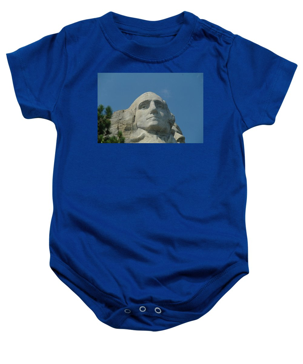 Mt Rushmore Baby Onesie featuring the photograph George Washington In Stone by Jeff Swan