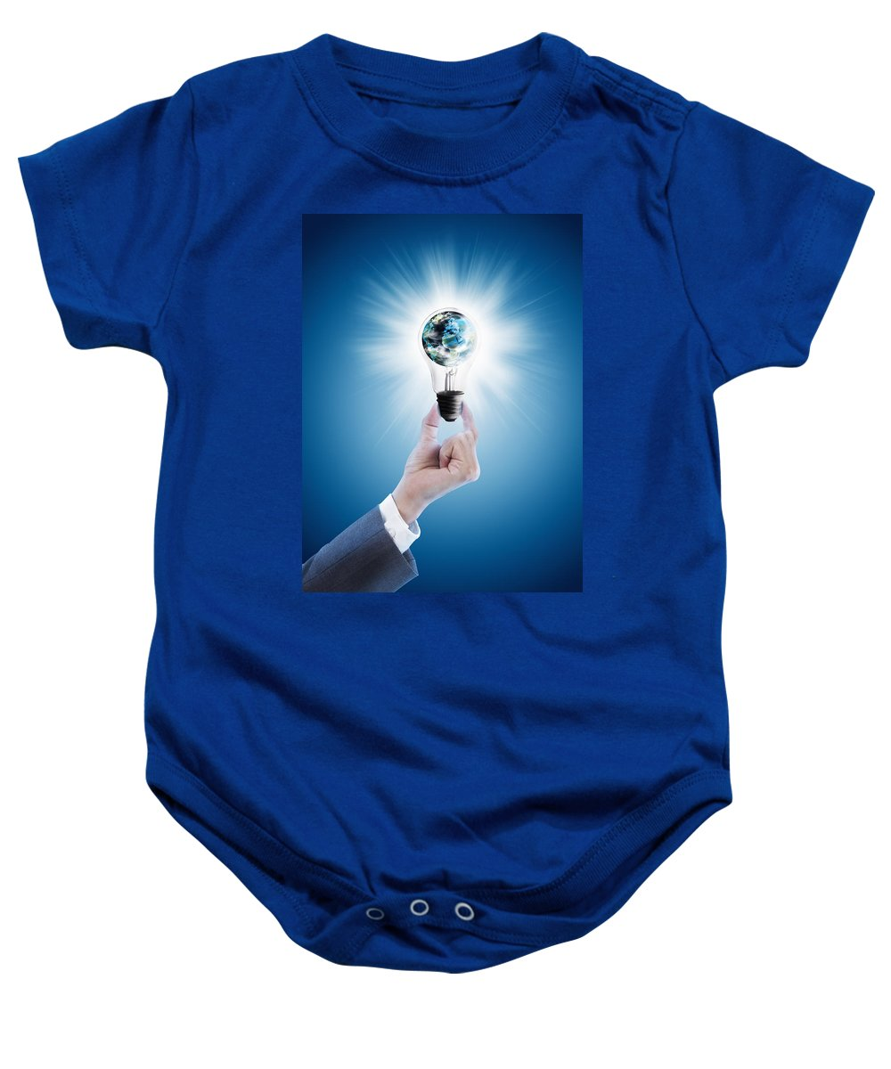 Background Baby Onesie featuring the photograph Hand Holding Light Bulb With Globe by Setsiri Silapasuwanchai