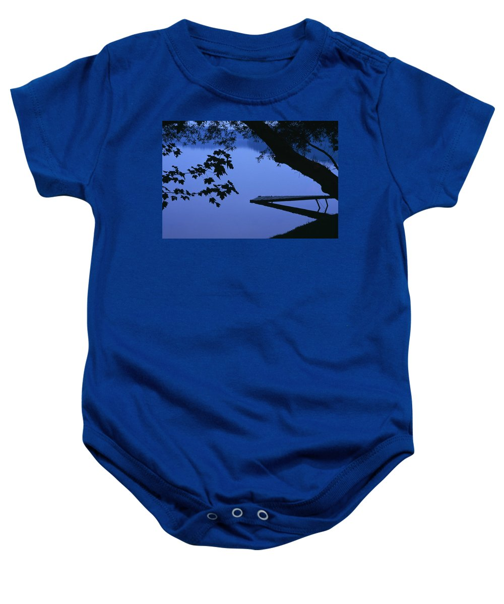 David Baby Onesie featuring the photograph Lake And Trees At Dusk by Natural Selection David Chapman