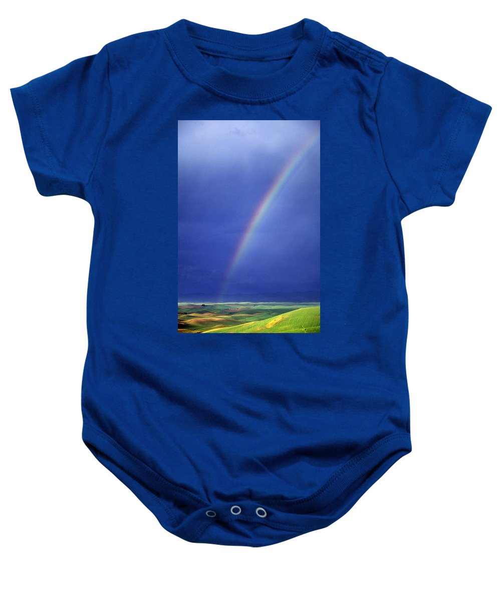 Color Image Baby Onesie featuring the photograph Rainbow Over Rolling Hills by Natural Selection Chris Pinchbeck