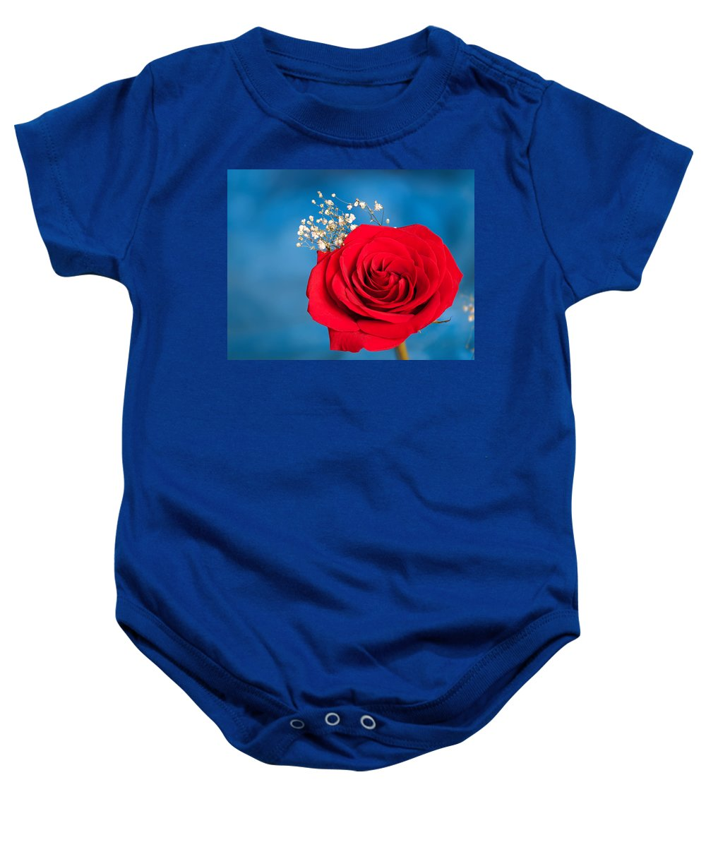 Red Rose On Blue Baby Onesie featuring the photograph Red Rose And Baby Breath by Randall Branham