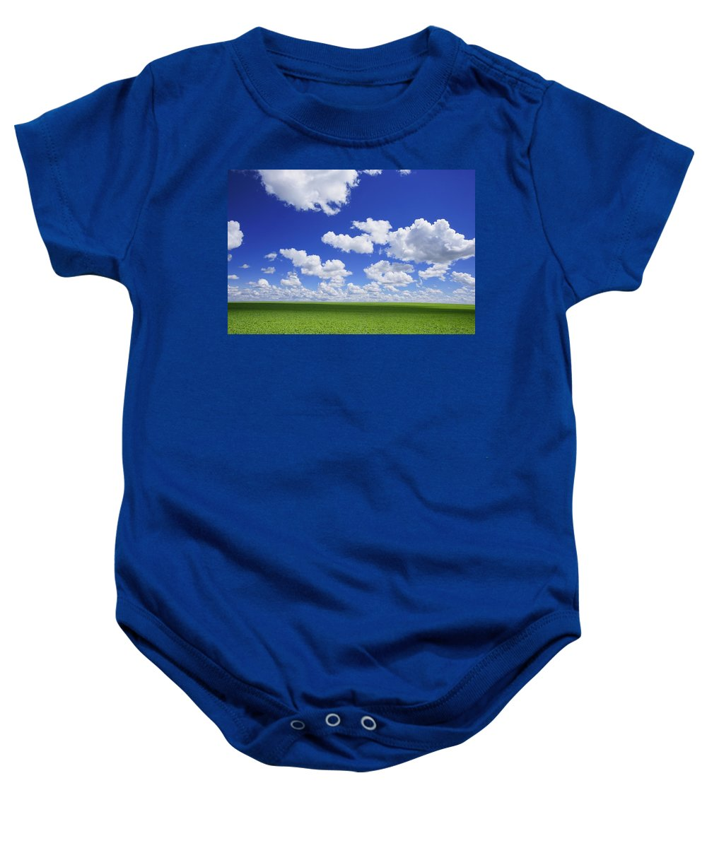 Canada Baby Onesie featuring the photograph White Clouds In The Sky And Green Meadow by Don Hammond