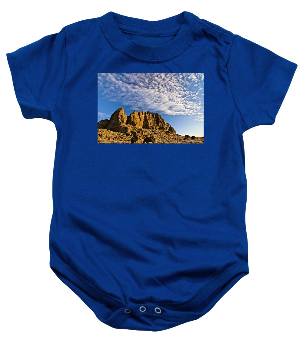 Fort Rock Baby Onesie featuring the photograph Fort Rock North Wall by Albert Seger