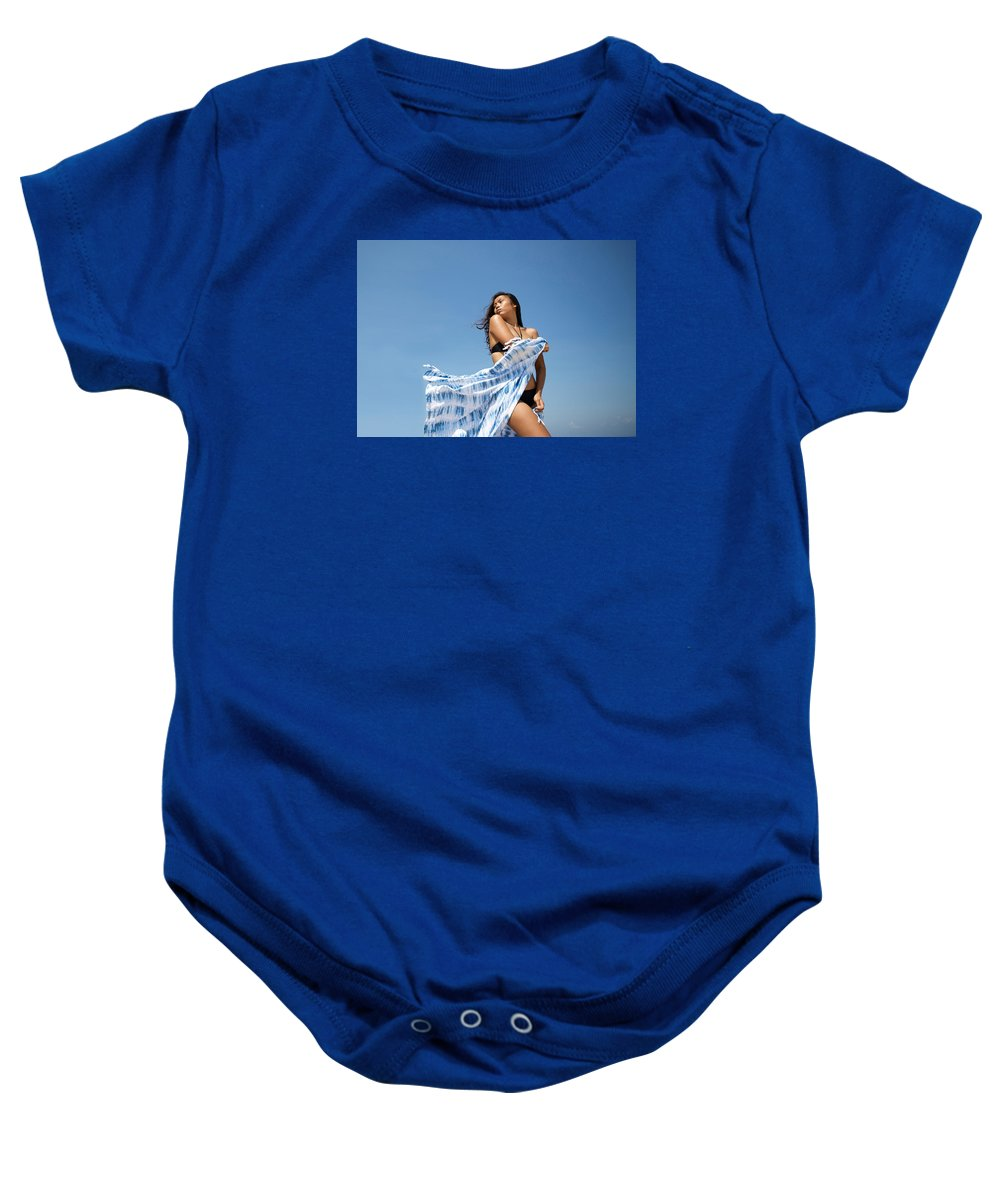 Indonesian Woman Baby Onesie featuring the photograph Woman On Beach by Norman Quinn