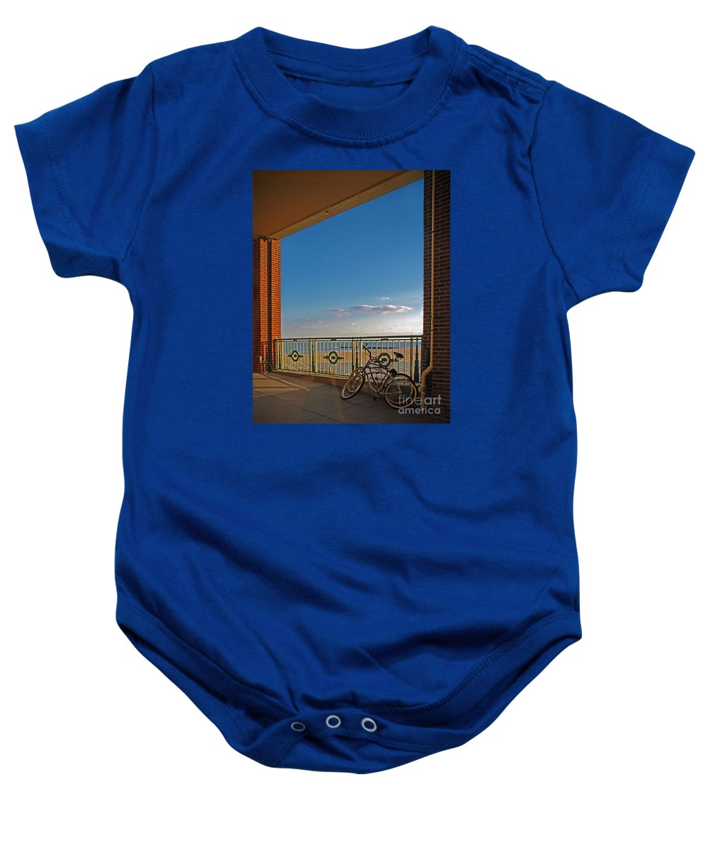 Bradley Baby Onesie featuring the photograph Bicycles Resting by Rich Despins