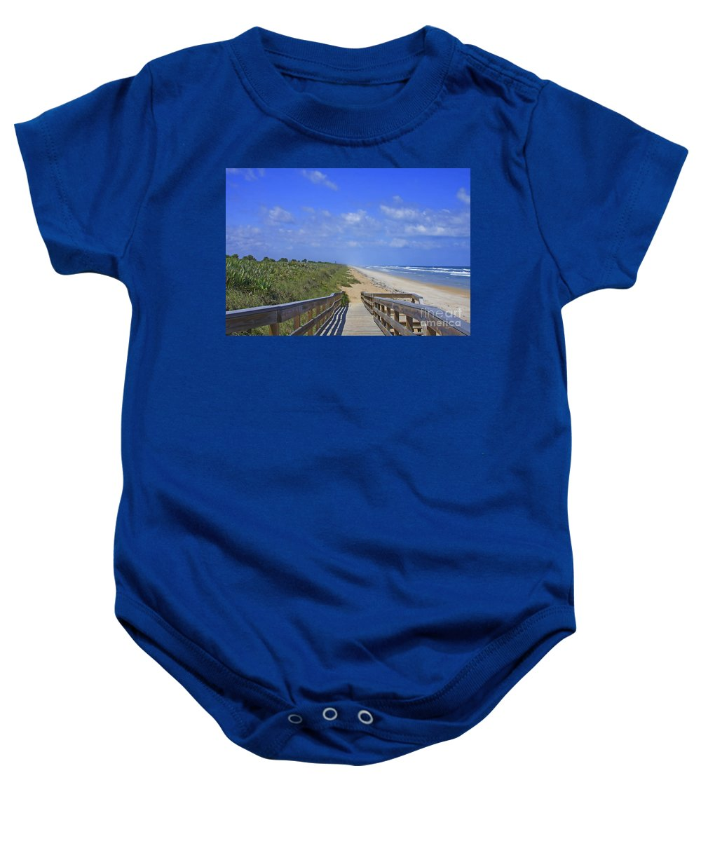 Canaveral Baby Onesie featuring the photograph Canaveral Walkway by Deborah Benoit