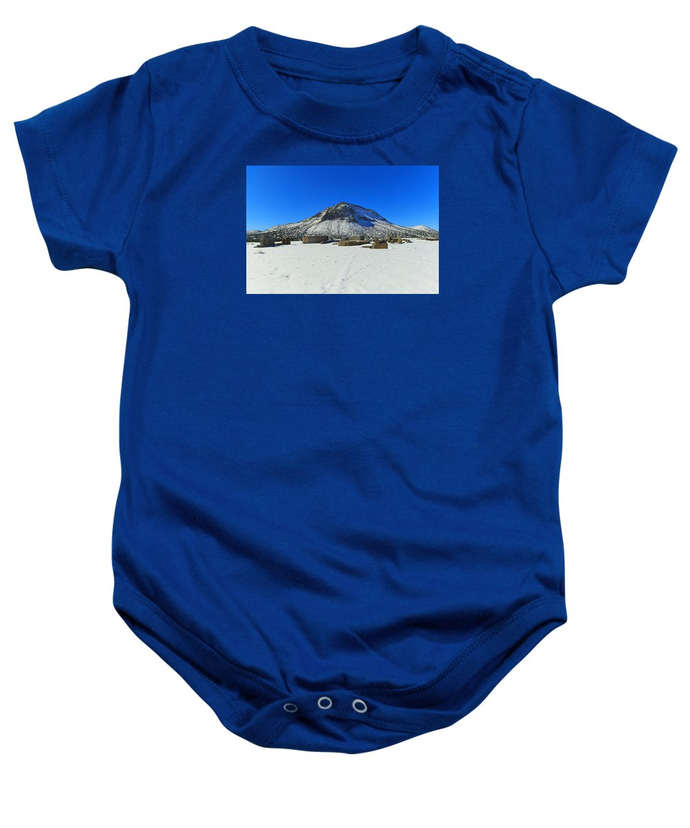 Mountain Baby Onesie featuring the photograph Mining Ruins Foreground A Snowy Mountain by Jeff Swan