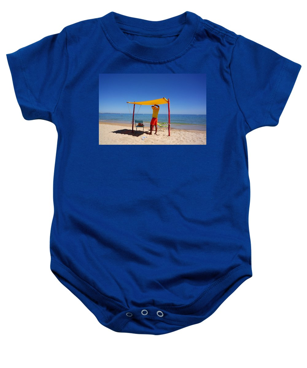 Life Guard Baby Onesie featuring the photograph Nadador Salvador by Charles Stuart