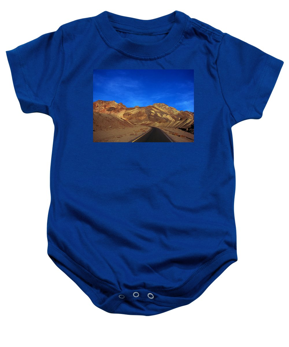 Landscape Baby Onesie featuring the photograph On The Road Again by Linda Arnn Arteno