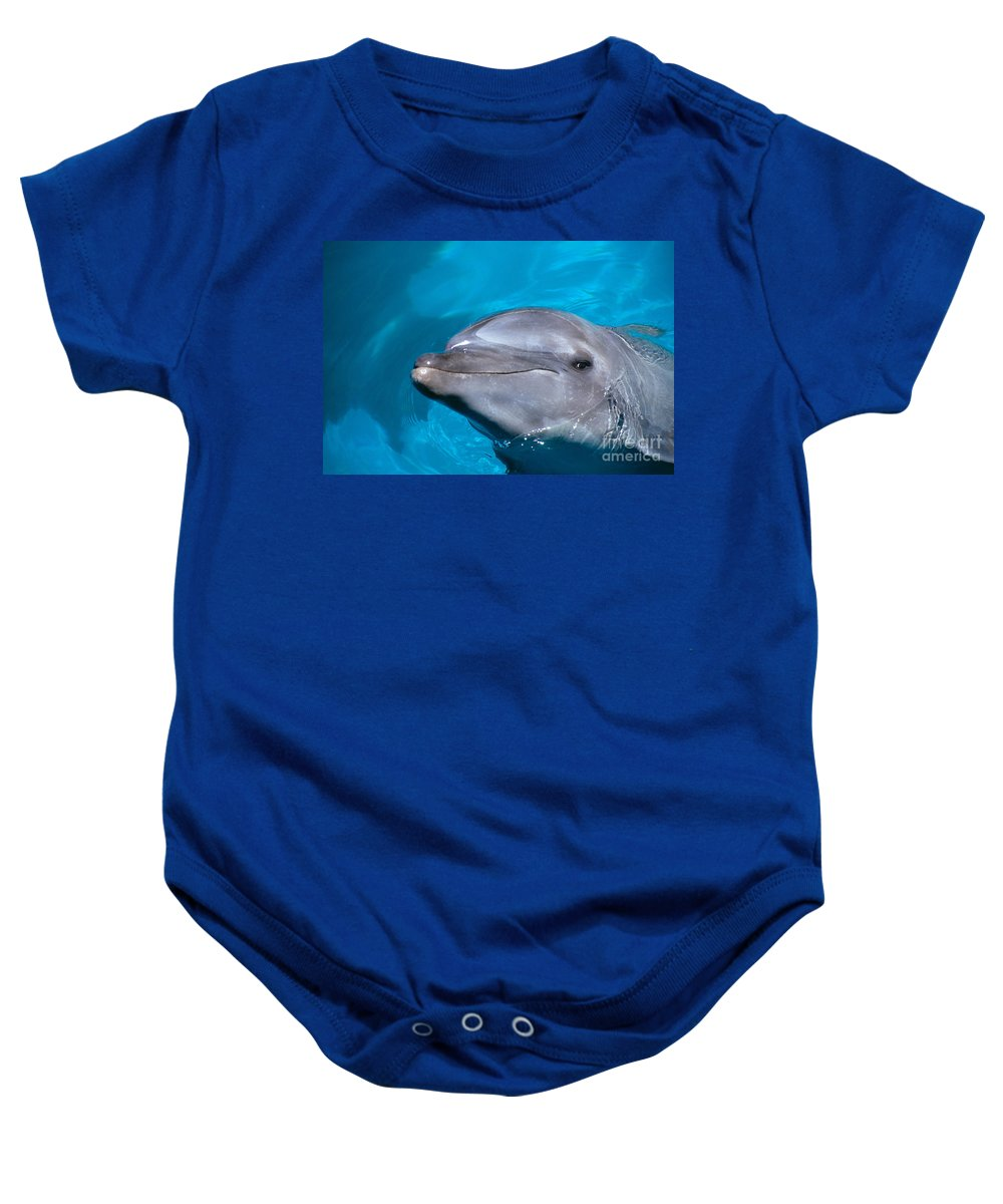 Animal Art Baby Onesie featuring the photograph Pacific Bottlenose Dolphi by Dave Fleetham - Printscapes