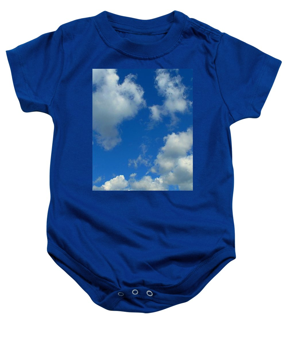 Clouds Baby Onesie featuring the photograph Ploughing Under A Mid Day Sun by Ian MacDonald