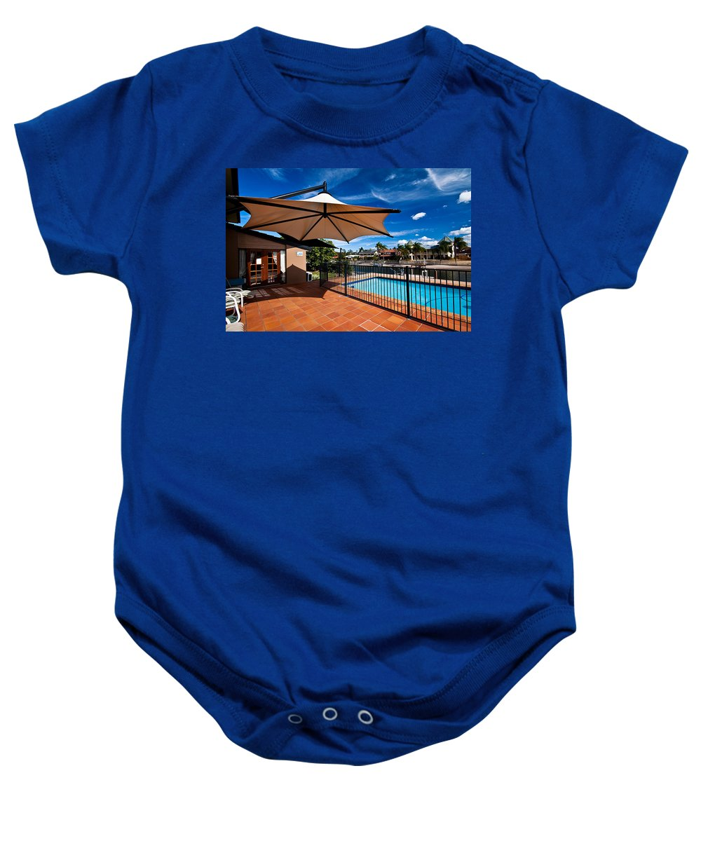 Blue Baby Onesie featuring the photograph Pool And Umbrella by Darren Burton