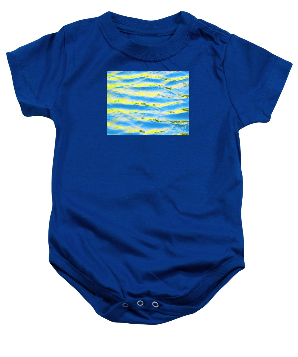 Calm Baby Onesie featuring the photograph Riding A Wave by Sybil Staples