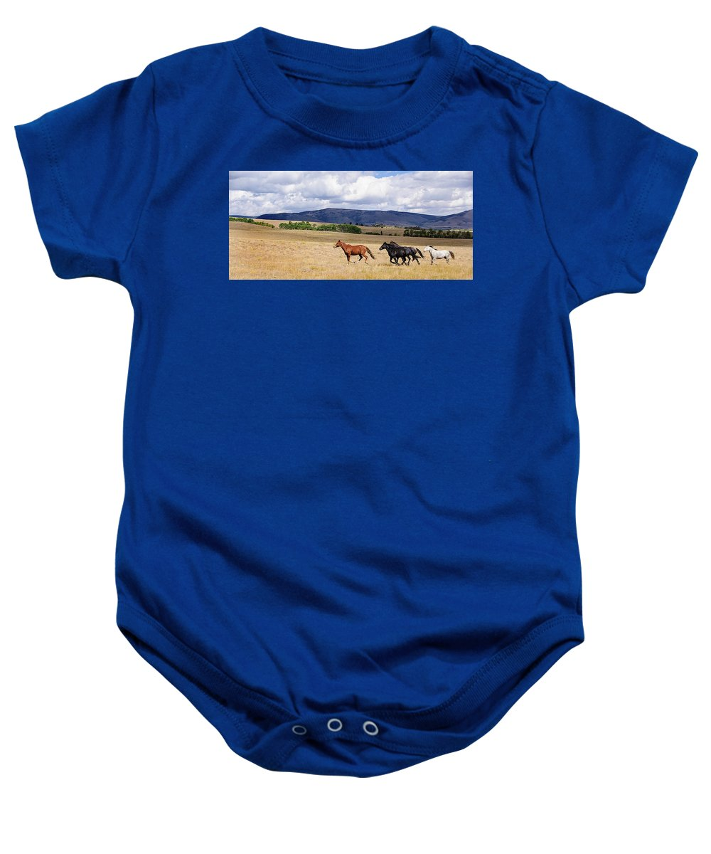 Wild Horses Baby Onesie featuring the photograph Running Into The Wind by Lisha Donald