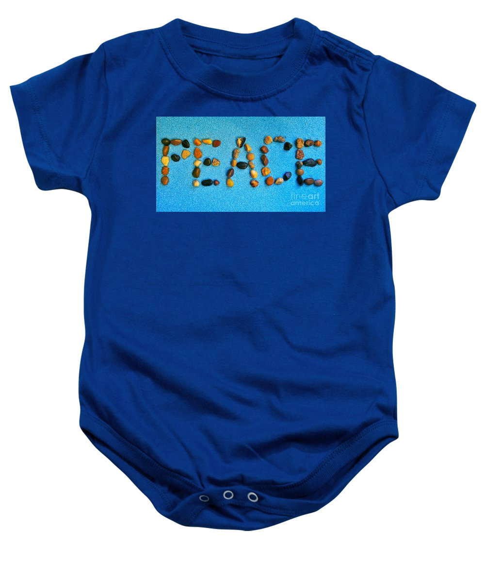 Peace Baby Onesie featuring the photograph Spelling Peace by Rachel Hannah