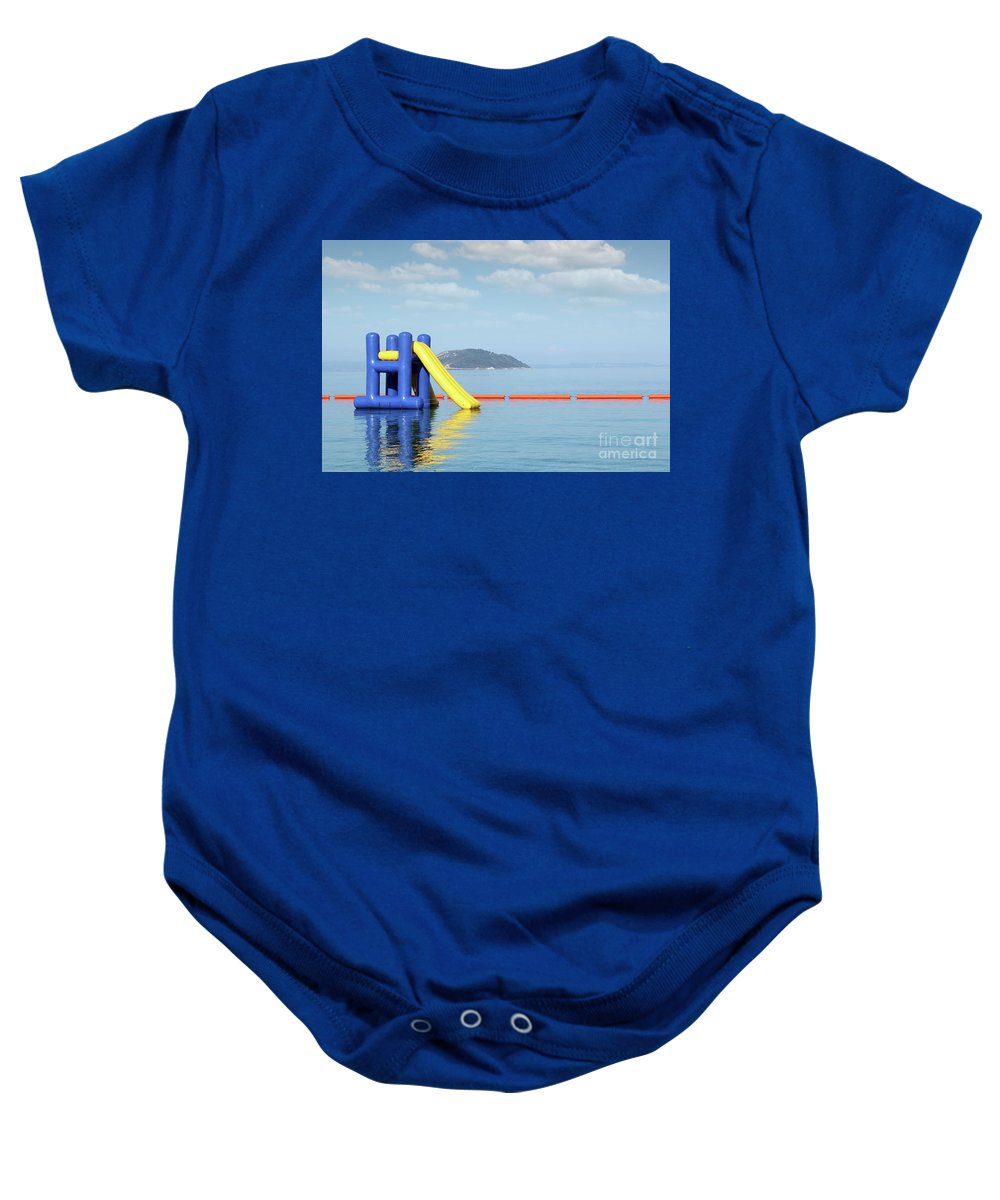 Sithonia Baby Onesie featuring the photograph Summer Vacation Scene With Water Slide by Goce Risteski