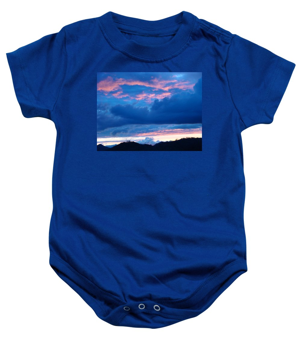 Sunset Baby Onesie featuring the photograph Sunset Art Print Blue Twilight Clouds Pink Glowing Light Over Mountains by Baslee Troutman