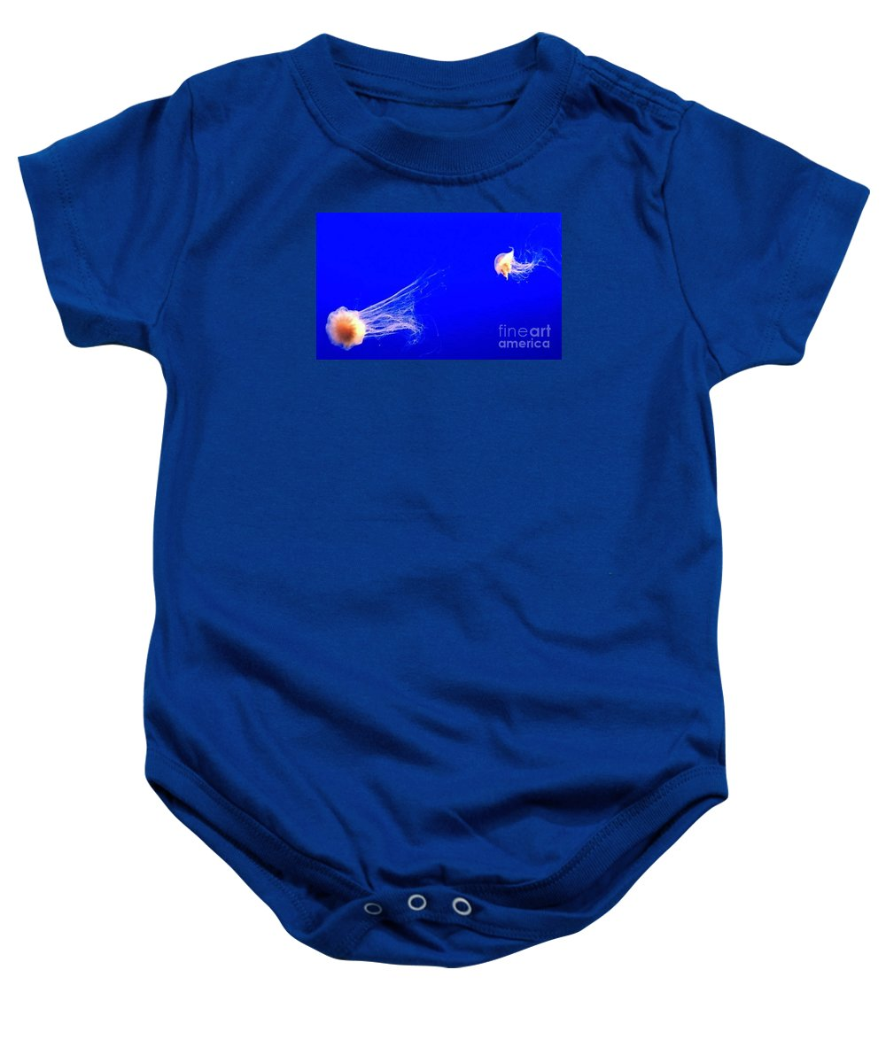 Ocean Baby Onesie featuring the photograph The Chase by Vanessa Palomino