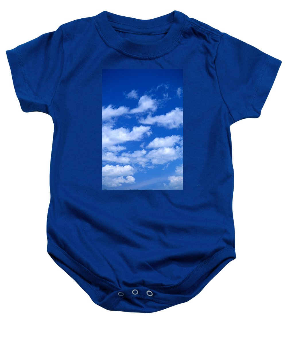 Air Baby Onesie featuring the photograph White Clouds by Kyle Rothenborg - Printscapes
