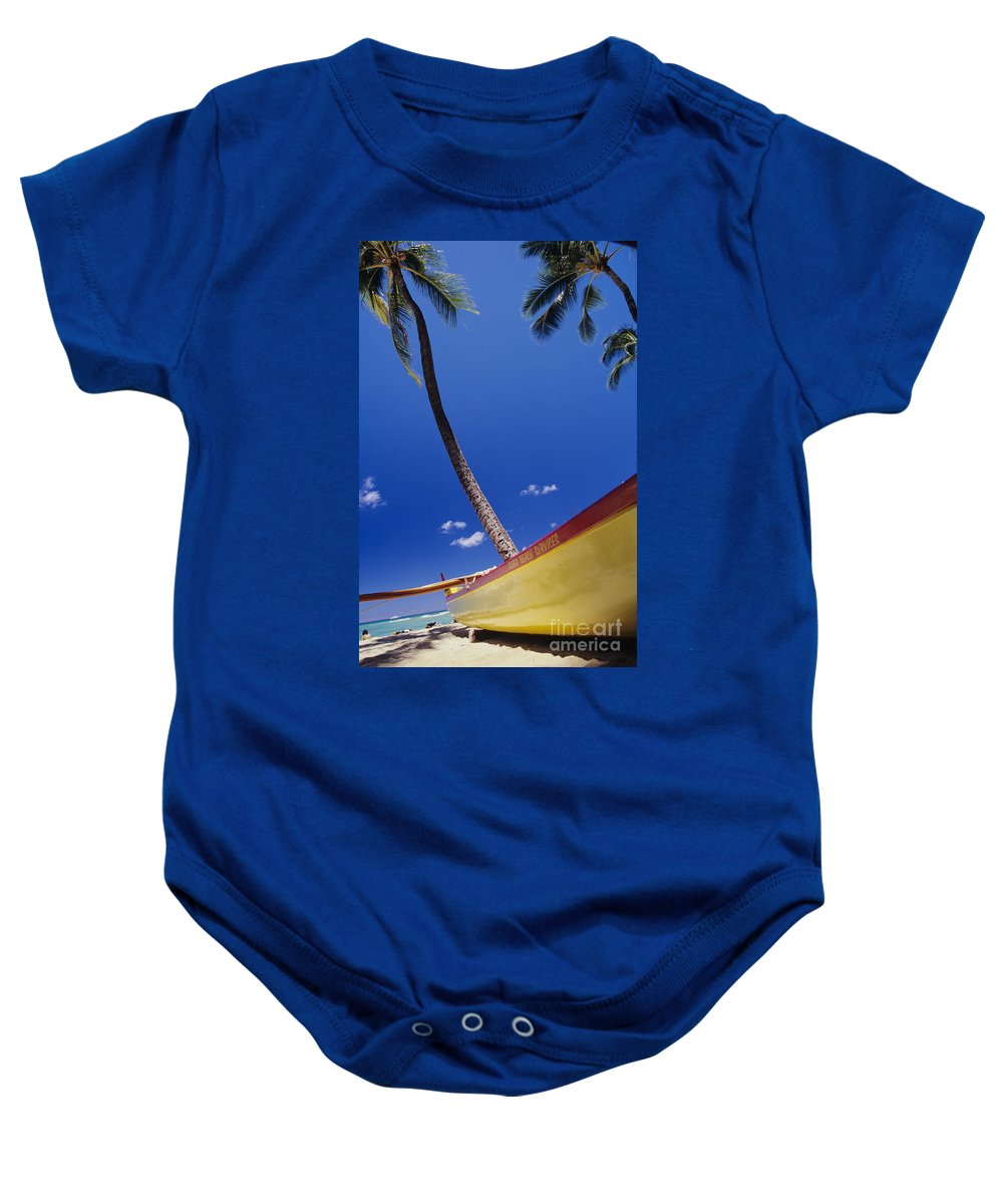 Aku Baby Onesie featuring the photograph Yellow Canoe On Beach by Joss - Printscapes