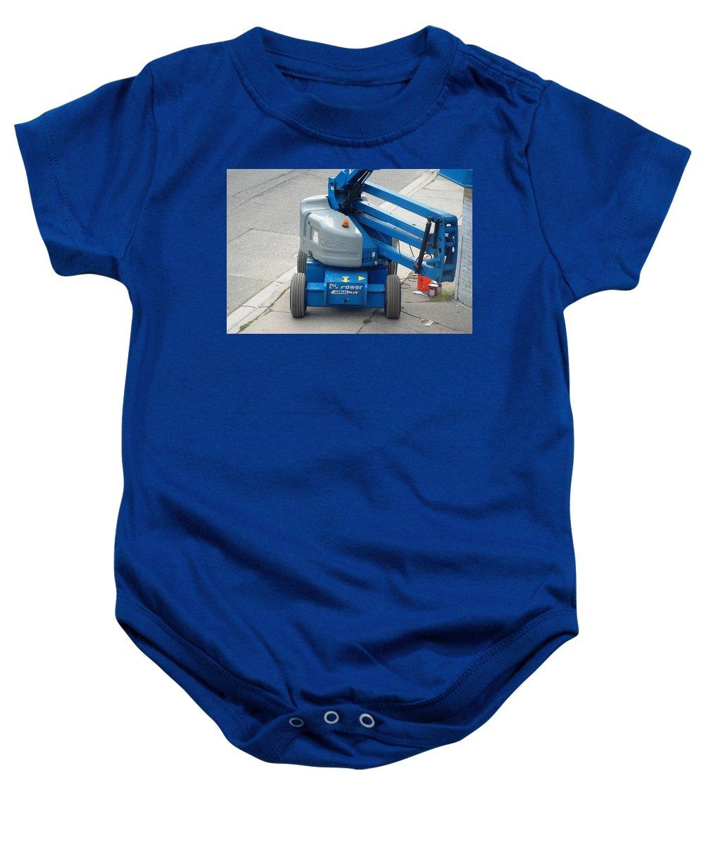 Boom Lift Genie Z45 Baby Onesie featuring the photograph A Boom Lift Genie Z45 Machine by Ee Photography