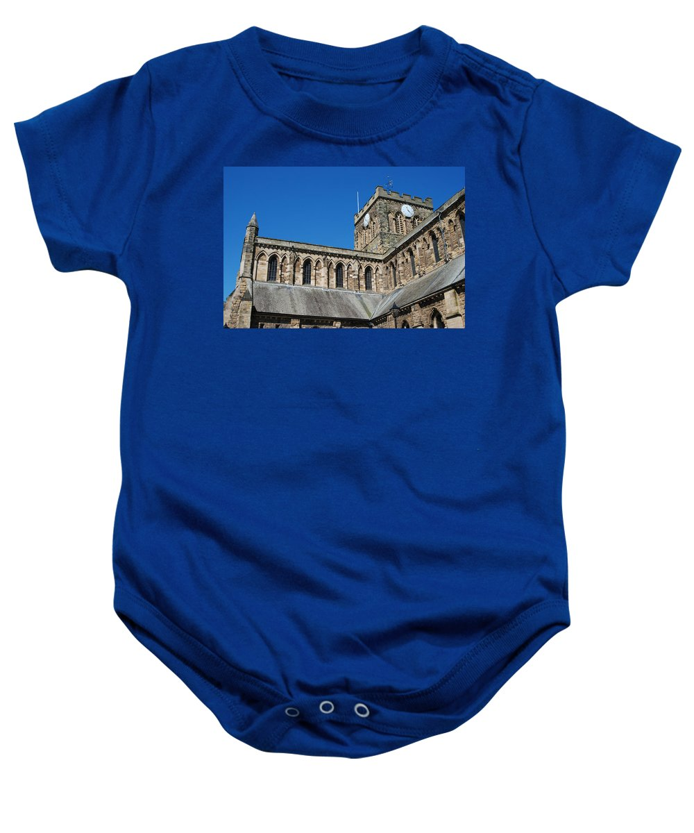 Hexham Baby Onesie featuring the photograph architecture of Hexham cathedral and clock tower by Victor Lord Denovan