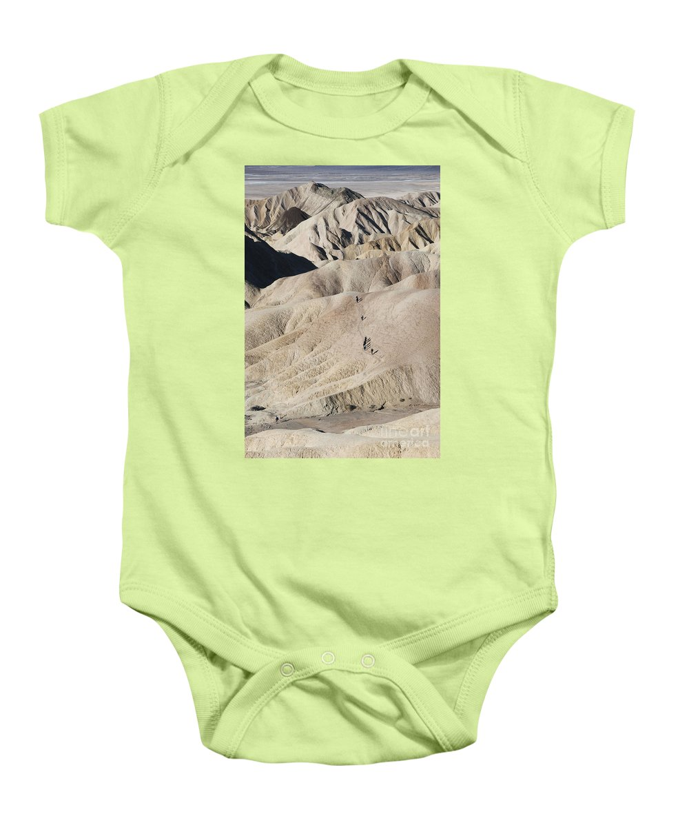 America Baby Onesie featuring the photograph Badlands by Juli Scalzi