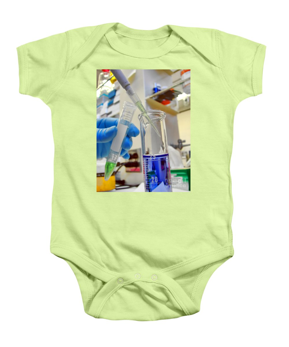 Test Baby Onesie featuring the photograph Scientific Experiment In Science Research Lab by Science Research Lab By Olivier Le Queinec