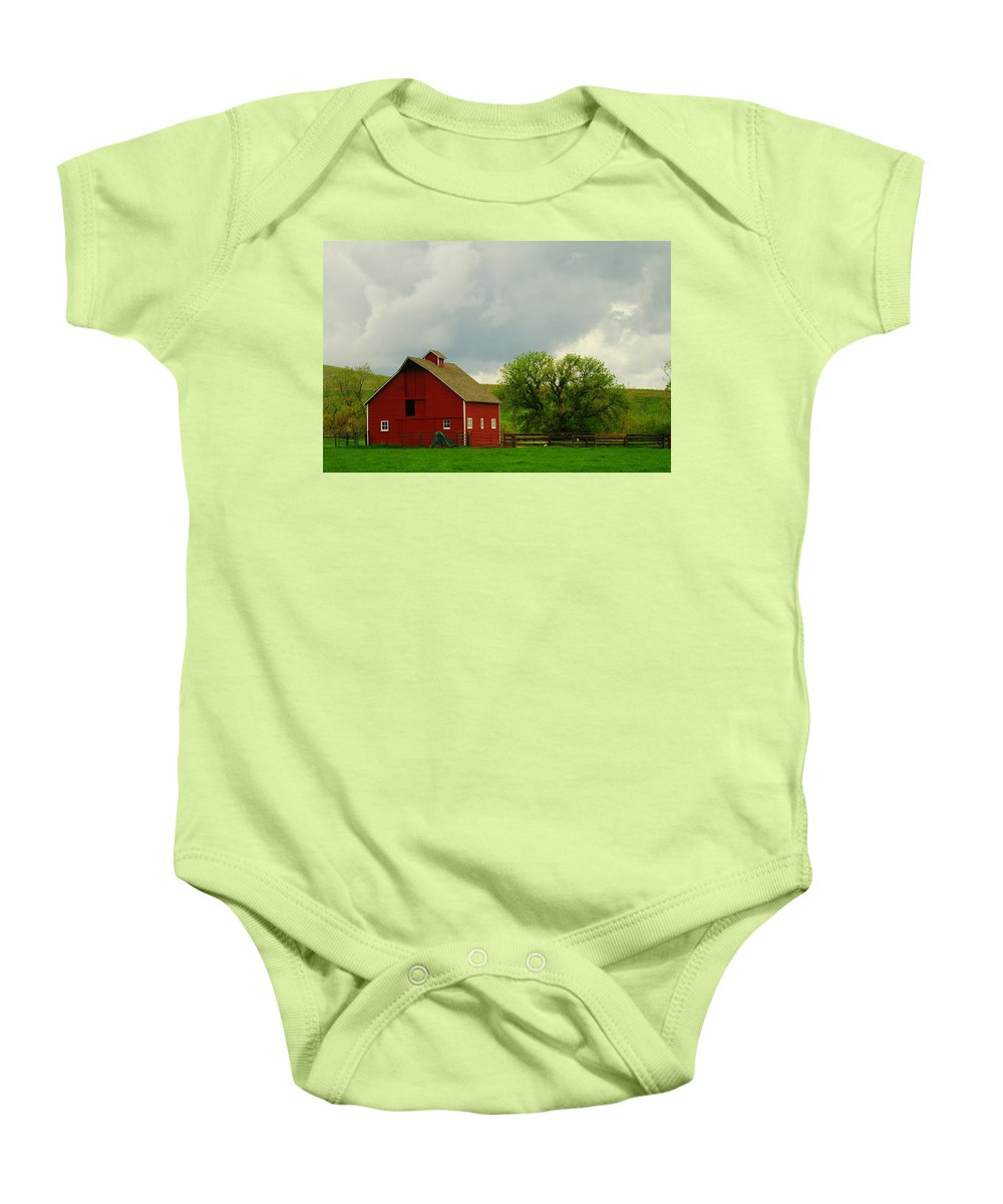 Barns Baby Onesie featuring the photograph A Neat Red Barn Near Sheridan Wyoming by Jeff Swan