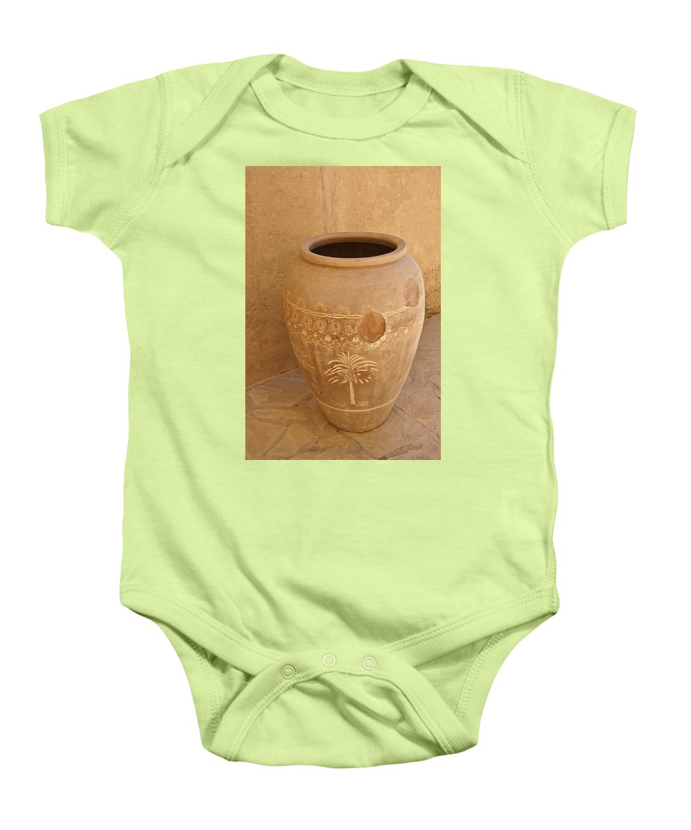 Africa Baby Onesie featuring the photograph Arabian Pottery by Michele Burgess
