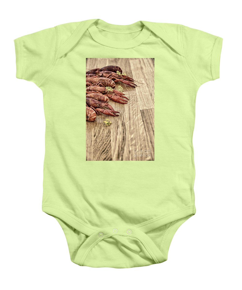 Dill Baby Onesie featuring the photograph Crayfish On Wooden Platter. by Sophie McAulay