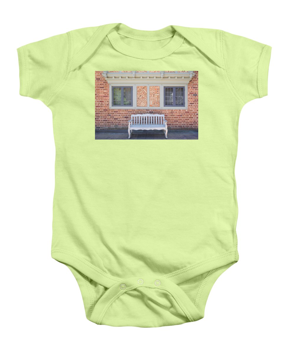 House Baby Onesie featuring the photograph House Brick Exterior With Wood Bench by Jit Lim
