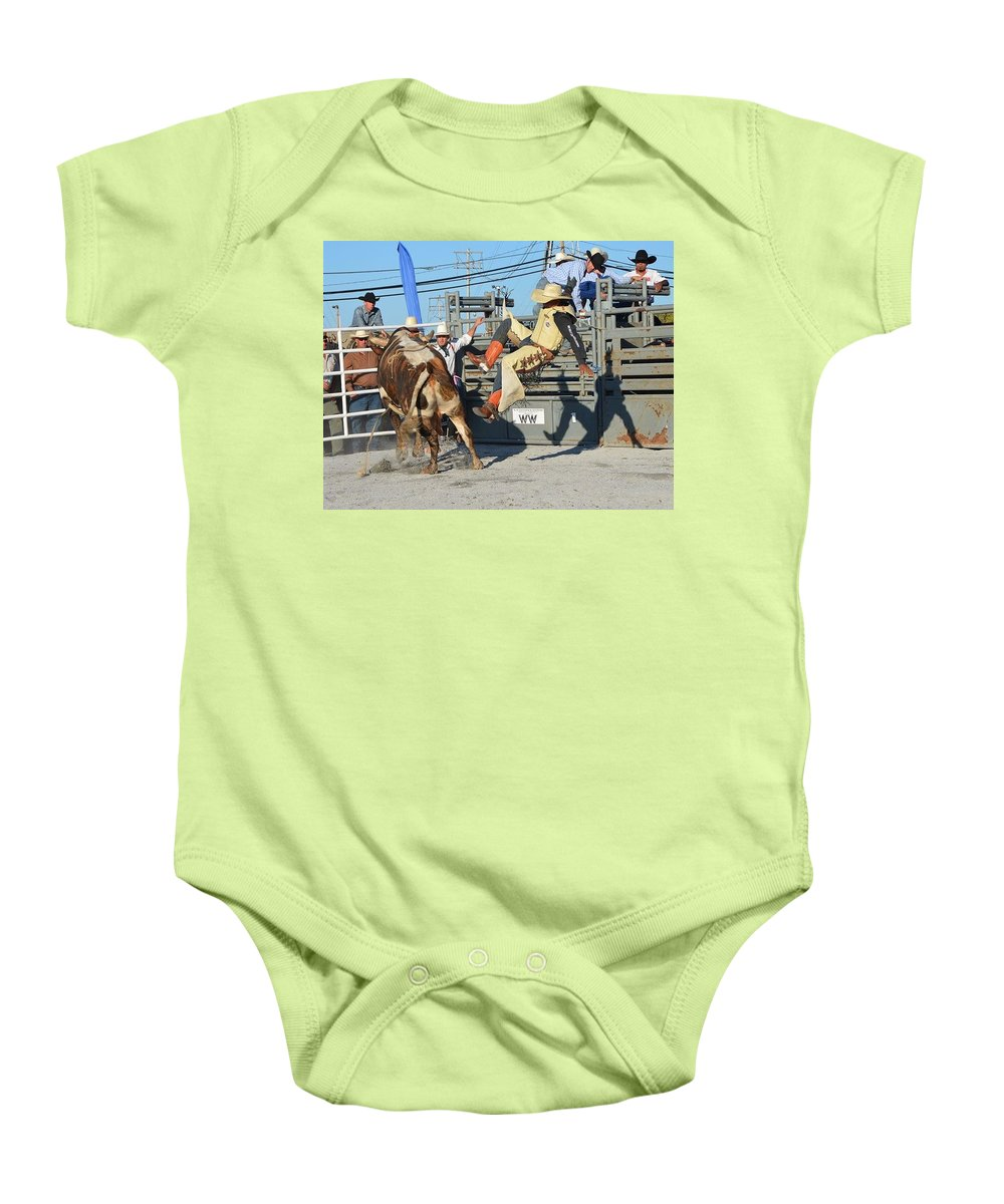Cowboy Baby Onesie featuring the photograph Flying Shadow by Michael Keough