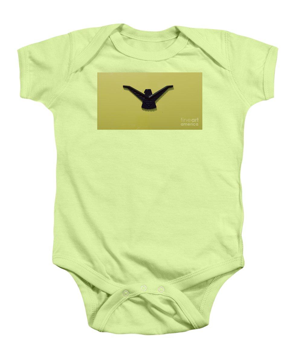 Thunderbird Baby Onesie featuring the photograph Thunderbird Emblem by Alys Caviness-Gober