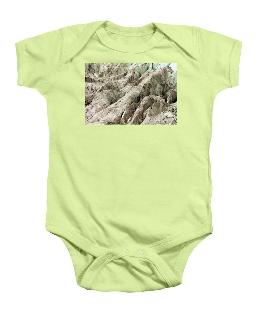 Alpine Baby Onesie featuring the photograph Tiny Man Walks Expansive Alpine Glacier Icefield by Stephan Pietzko