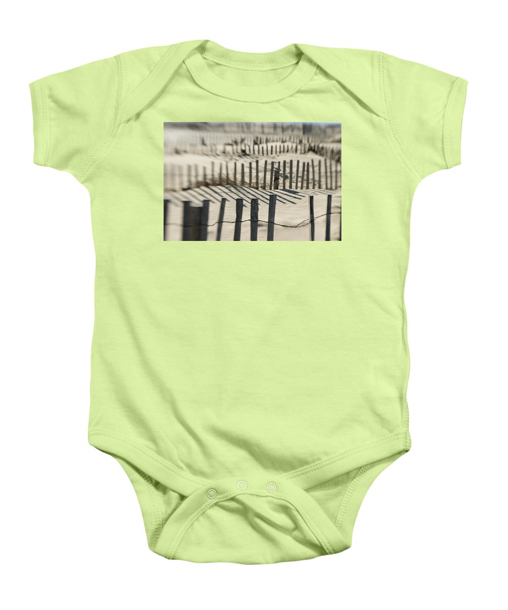 British Columbia Baby Onesie featuring the photograph Slats Of Wooden Fence Throwing Shadows by Helene Cyr