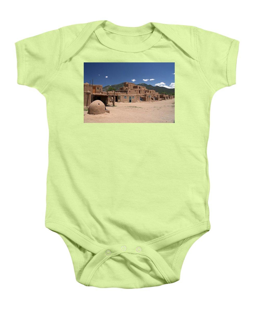 Taos Baby Onesie featuring the photograph Taos Pueblo by Elizabeth Rose