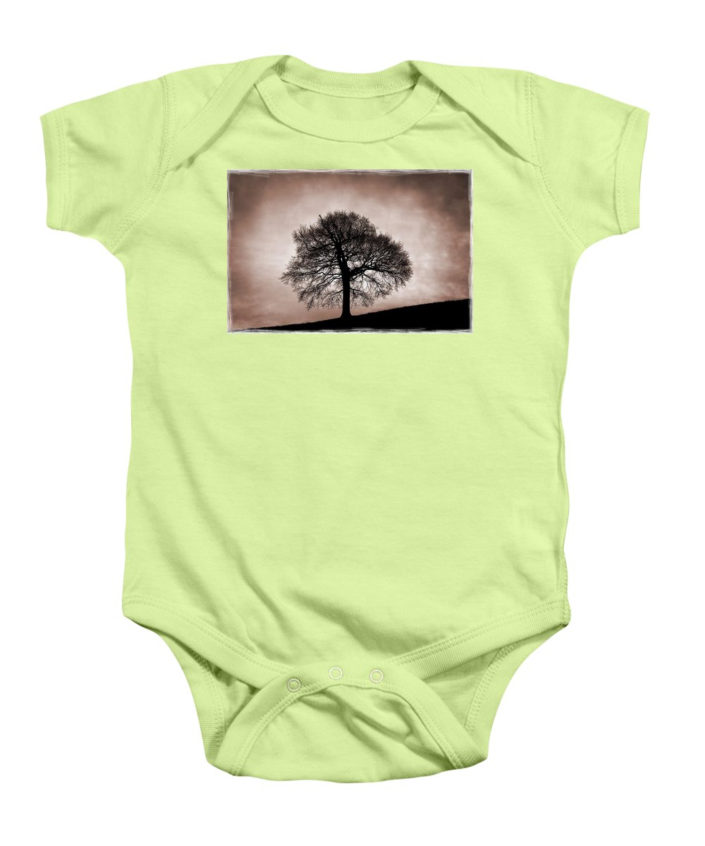 Nottinghamshire Baby Onesie featuring the photograph Tree Against A Stormy Sky by Chris Upton