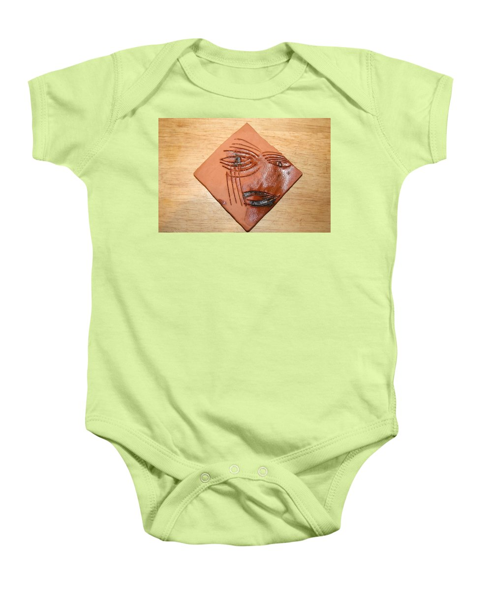 Jesus Baby Onesie featuring the ceramic art Agony - Tile by Gloria Ssali