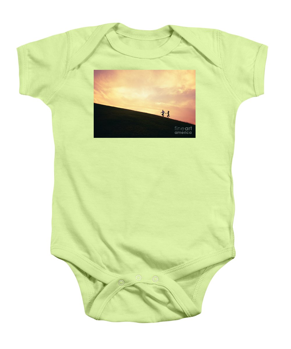 Active Baby Onesie featuring the photograph Couple On Hill by Dana Edmunds - Printscapes