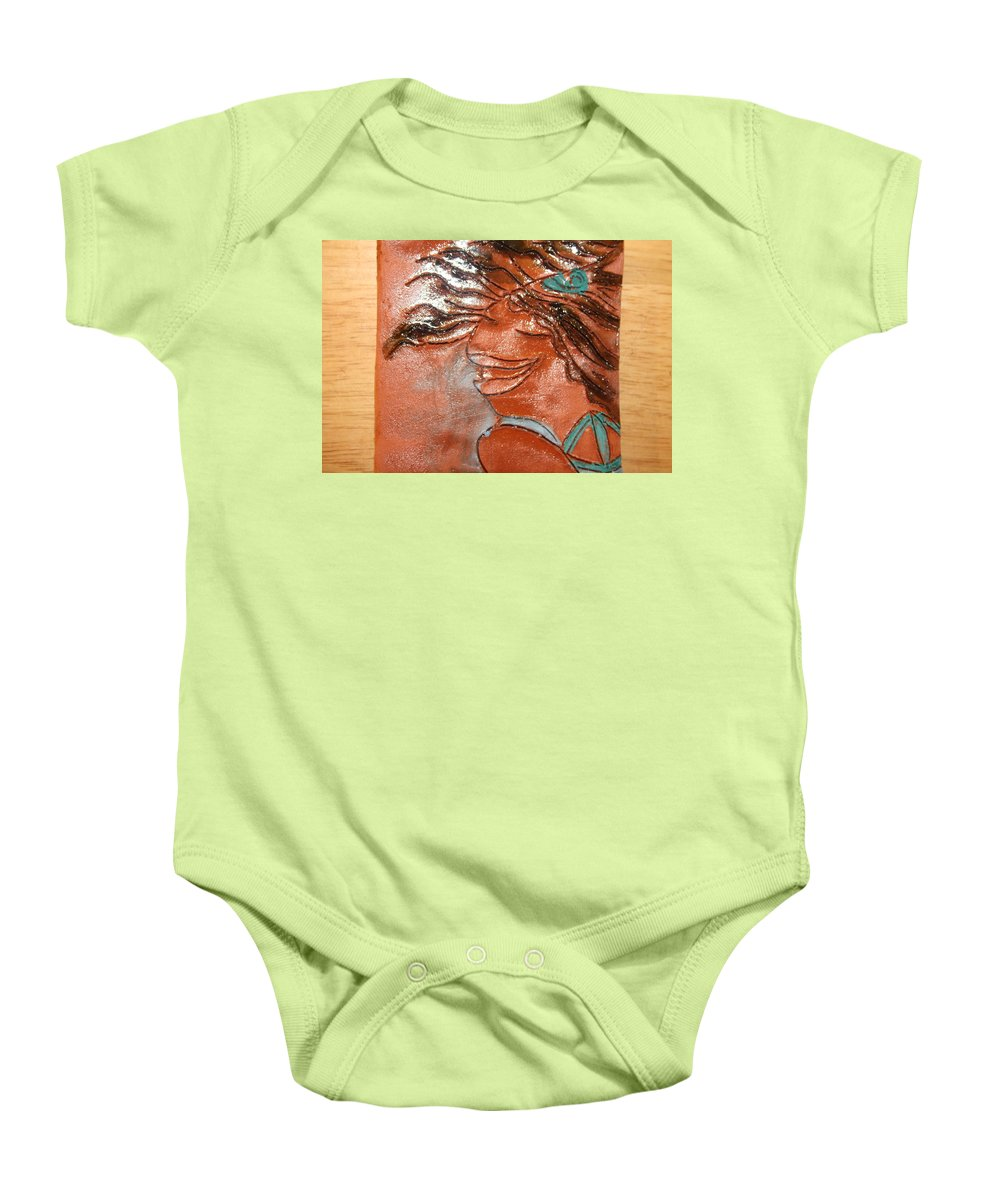 Jesus Baby Onesie featuring the ceramic art Della - Tile by Gloria Ssali
