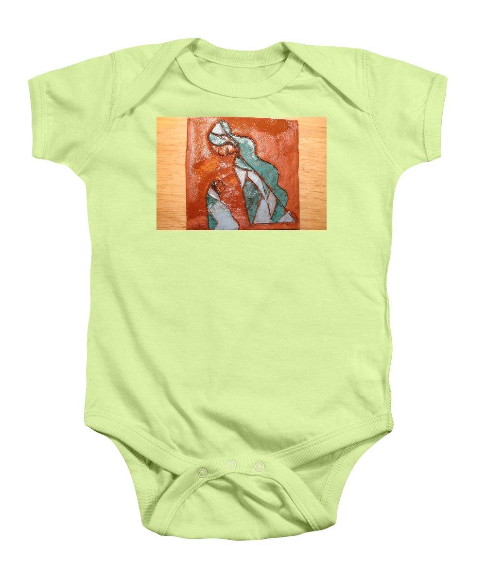 Jesus Baby Onesie featuring the ceramic art Dellas Gal - Tile by Gloria Ssali