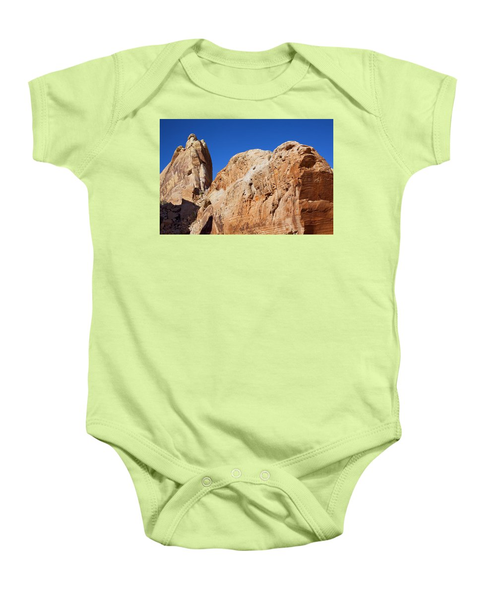 Rock Face Baby Onesie featuring the photograph Rock Face by Kelley King
