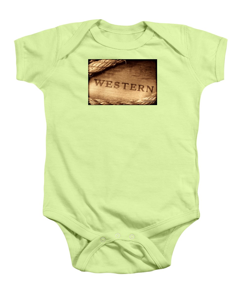 Western Baby Onesie featuring the photograph Western Stamp Branding by American West Legend By Olivier Le Queinec