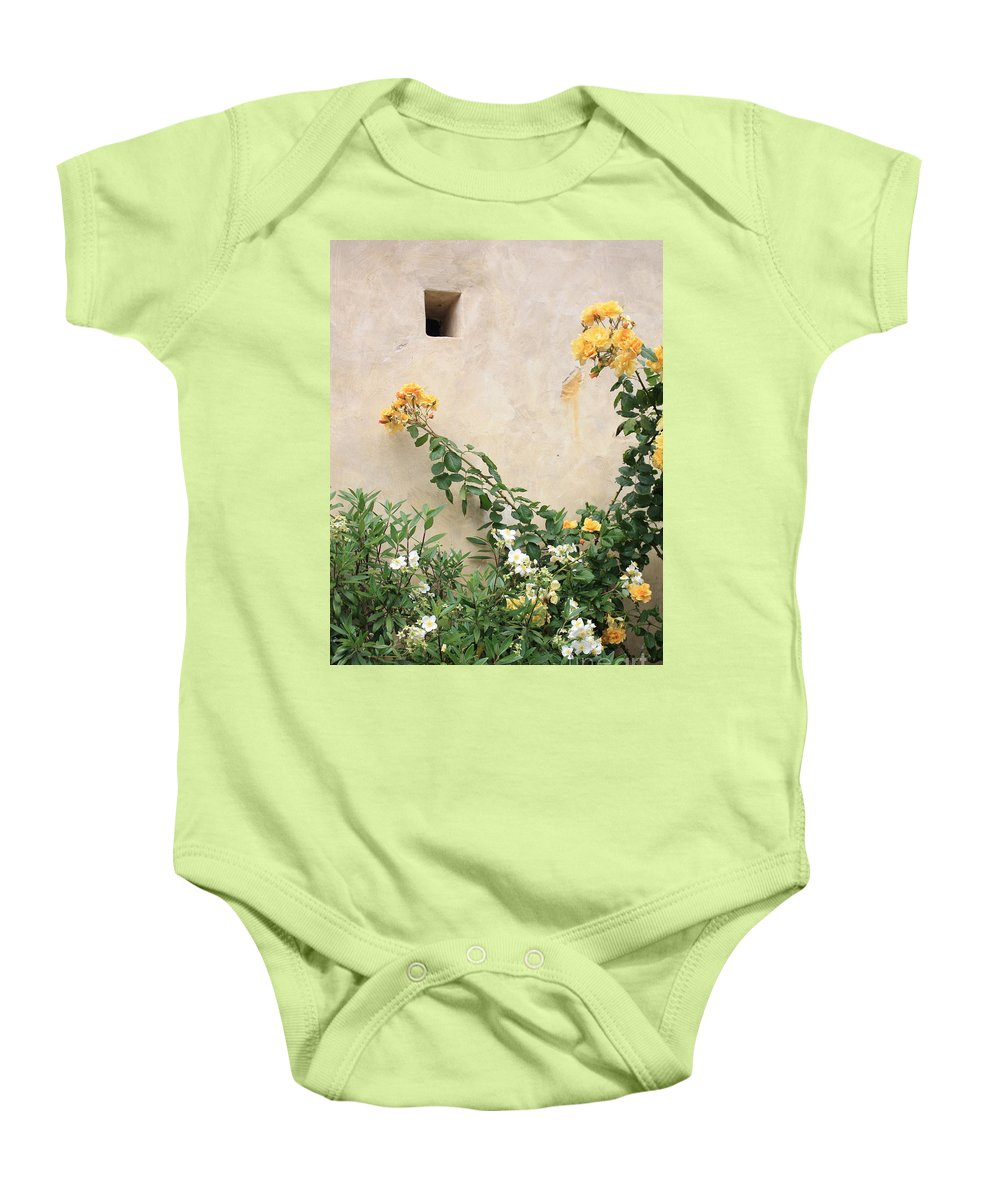 Yellow Roses Baby Onesie featuring the photograph Yellow Roses And Tiny Window At Carmel Mission by Carol Groenen