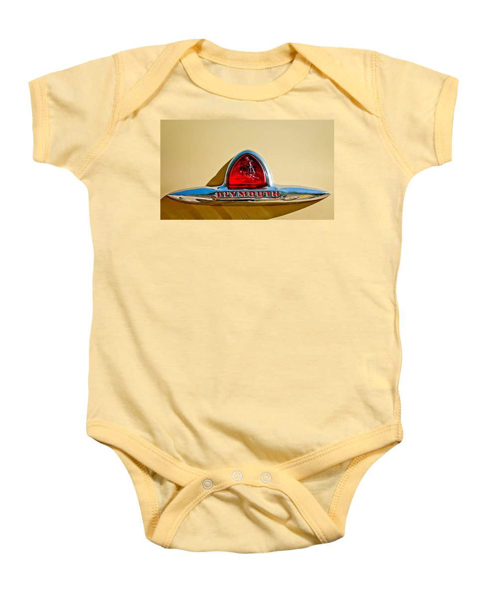 1948 Plymouth Deluxe Emblem Baby Onesie featuring the photograph 1948 Plymouth Deluxe Emblem by Jill Reger